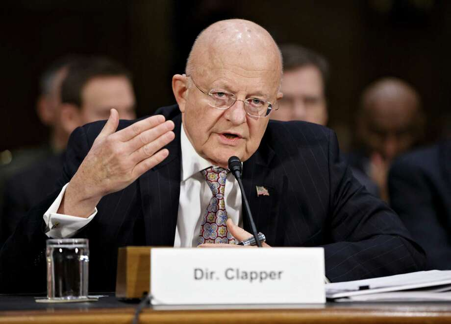 U.S. intel director James Clapper said the U.S. needs to remember it conducts the same type of economic cyber spying China has promised not to do. Photo: Associated Press /File Photo / AP