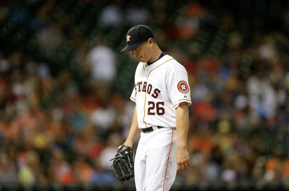 Houston Astros starting pitcher Scott Kazmir (26) walks off the mound replaced by Houston Astros relief pitcher Chad Qualls (50) in the top of the fifth inning in a game played at Minute Maid Park Wednesday, Sept. 2, 2015, in Houston, Texas. ( Gary Coronado / Houston Chronicle ) Photo: Gary Coronado, Staff / © 2015 Houston Chronicle