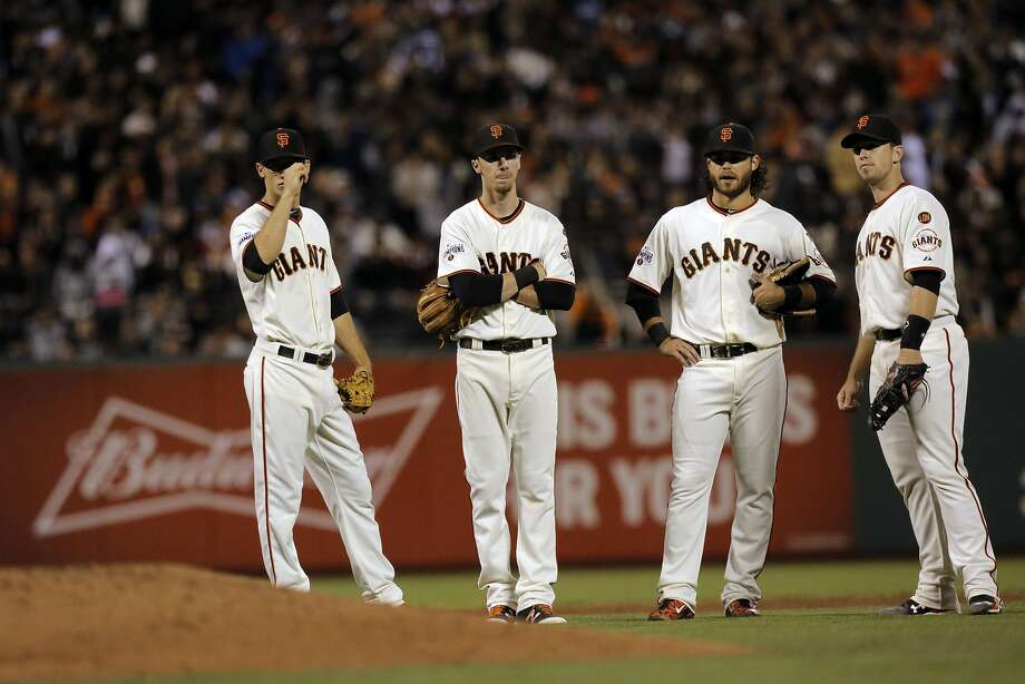 Kelby Tomlinson, Matt Duffy, Brandon Crawford and Buster Posey at AT&T Park on September 29, 2015. Photo: Michael Macor, The Chronicle