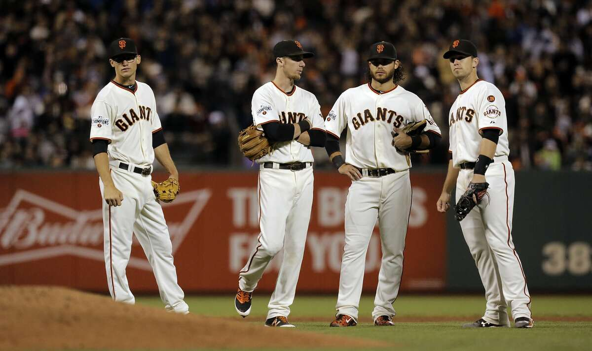 ( l to r) Kelby Tomlinson, Matt Duffy, Brandon Crawford and Buster Posey wait during a pitching change, after two home runs in the 6th inning to put San Francisco down 4-0, as the San Francisco Giants taker on the Los Angeles Dodger at AT&T Park in San Francisco, Calif., on Tues. September 29, 2015.