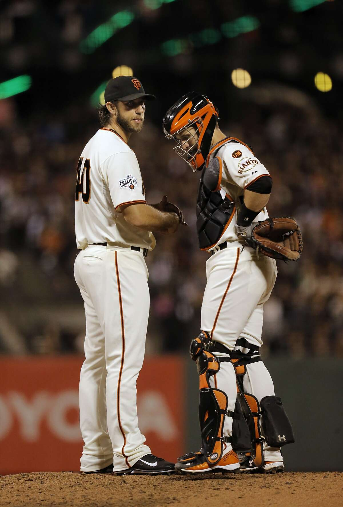 Giants' starting pitcher Madison Bumgarner is visited by catcher Buster Posey after giving the first of what would be two home runs to the Dodgers in the 6th inning, as the San Francisco Giants taker on the Los Angeles Dodger at AT&T Park in San Francisco, Calif., on Tues. September 29, 2015.