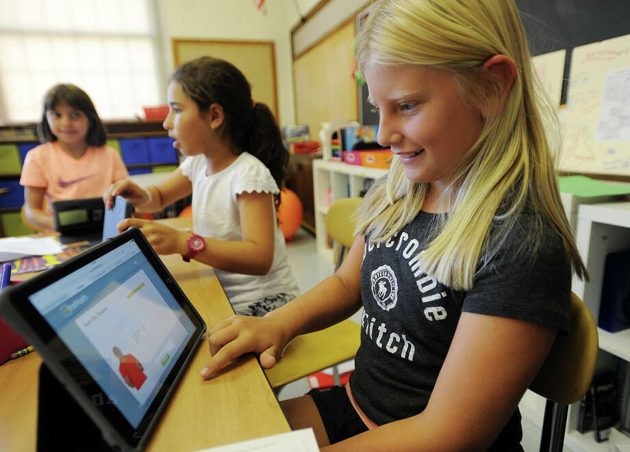 Kiki Cohen, 9, works with the learning program Khan Academy on her Ipad in her fifth grade classroom at Riverside School in Greenwich, Conn. on Thursday, September 24, 2015. Photo: Brian A. Pounds / Hearst Connecticut Media / Connecticut Post