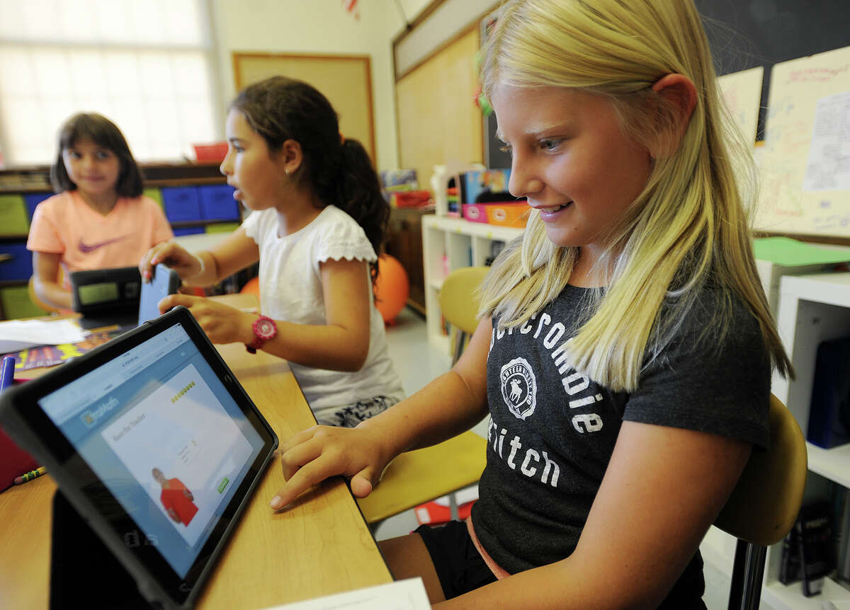 Kiki Cohen, 9, works with the learning program Khan Academy on her Ipad in her fifth grade classroom at Riverside School in Greenwich, Conn. on Thursday, September 24, 2015.