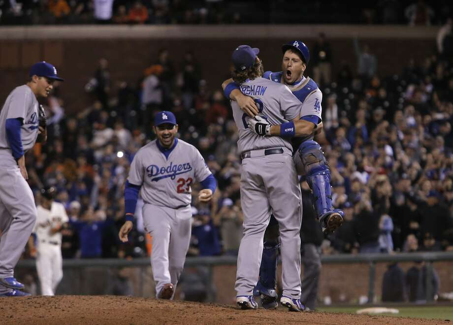 Pitcher Clayton Kershaw celebrates with catcher A. J. Ellis as the Los Angeles Dodgers beat the San Francisco Giants 8-0 at AT&T Park in San Francisco, Calif., on Tues. September 29, 2015. Photo: Michael Macor, The Chronicle