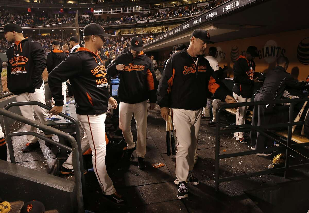 Pitcher Matt Cain, (left) and manager Bruce Bochy head to the clubhouse after the San Francisco Giants lost to the Los Angeles Dodgers 8-0 at AT&T Park in San Francisco, Calif., on Tues. September 29, 2015.