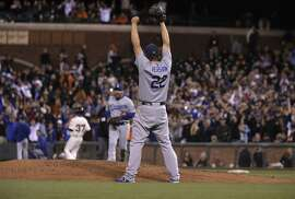 Pitcher Clayton Kershaw celebrates as the Los Angeles Dodgers beat the San Francisco Giants 8-0 at AT&T Park in San Francisco, Calif., on Tues. September 29, 2015.