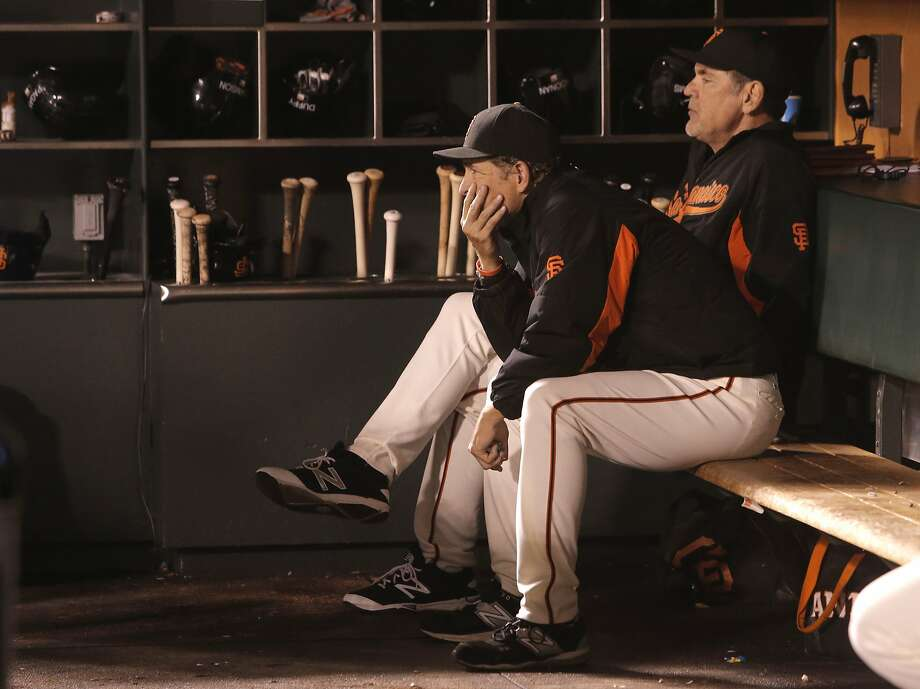 Pitching coach Dave Reghetti, (left) and Manager Bruce Bochy watch from the dugout as the Los Angeles Dodgers went on to beat the San Francisco Giants 8-0 at AT&T Park in San Francisco, Calif., on Tues. September 29, 2015. Photo: Michael Macor, The Chronicle