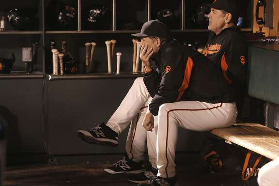 Pitching coach Dave Reghetti, (left) and Manager Bruce Bochy watch from the dugout as the Los Angeles Dodgers went on to beat the San Francisco Giants 8-0 at AT&T Park in San Francisco, Calif., on Tues. September 29, 2015.