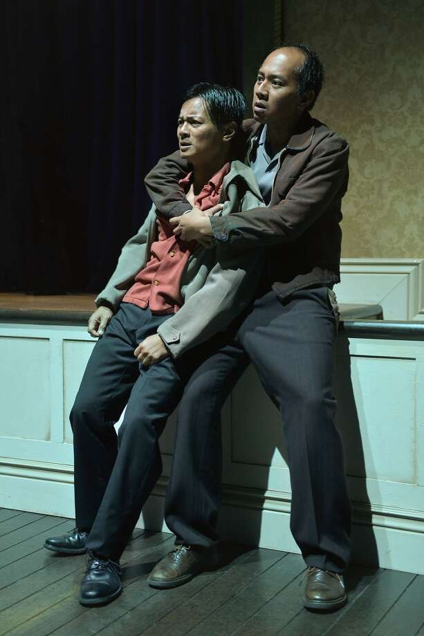 """Vicente (Ogie Zulueta) is comforted by Fortunado (Jomar Tagatac) in """"Remember the I-Hotel"""" at ACT's Strand Theater. Photo: Kevin Berne"""