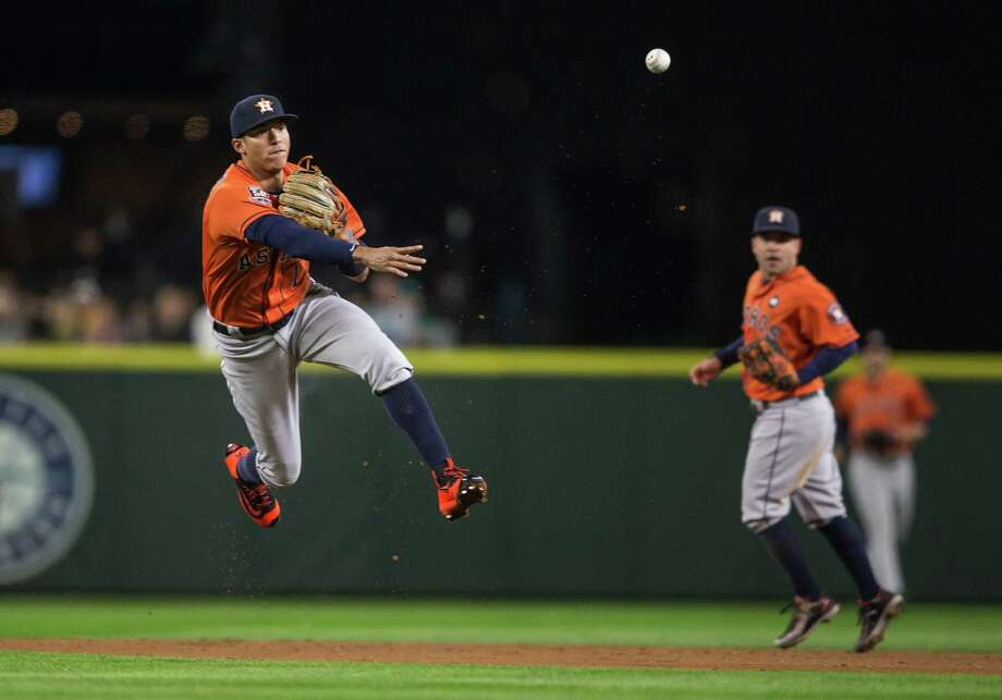 Carlos Correa makes a nifty play to retire the Mariners' James Jones in the second. Photo: Dean Rutz, MBR / Seattle Times