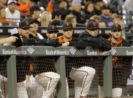 Players line the dugout railing late in the game, as the San Francisco Giants went on to lose to the Los Angeles Dodgers 8-0 at AT&T Park in San Francisco, Calif., on Tues. September 29, 2015.