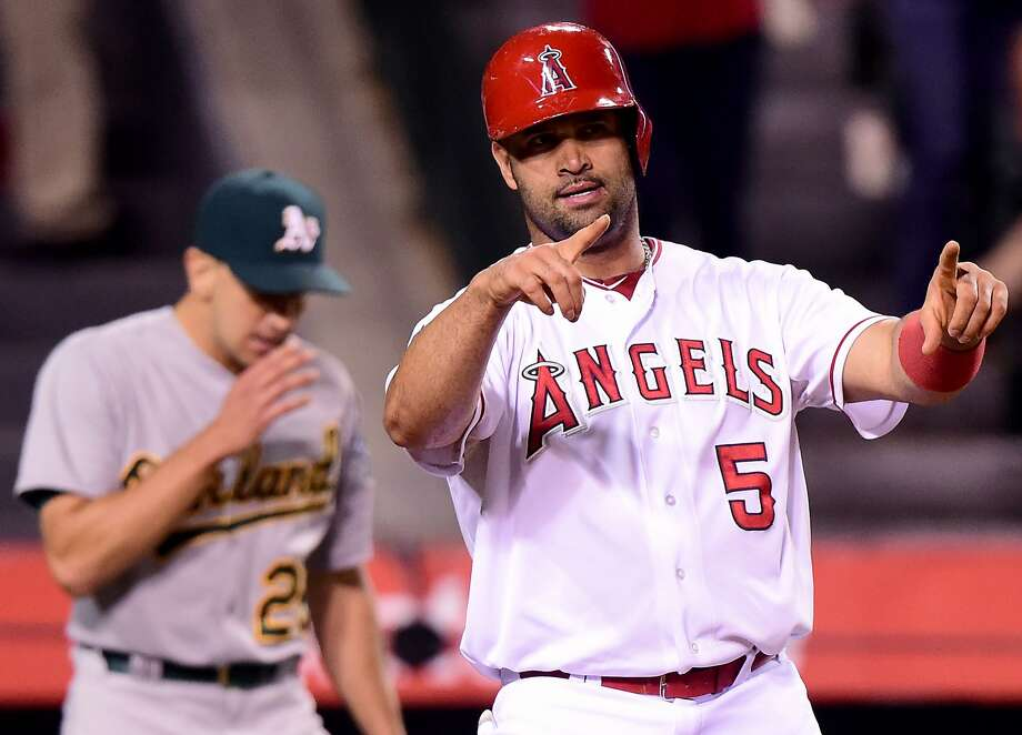Albert Pujols #5 of the Los Angeles Angels reacts to his run in front of Pat Venditte #29 of the Oakland Athletics to take a 7-1 lead during the fifth inning at Angel Stadium of Anaheim on September 29, 2015 in Anaheim, California. Photo: Harry How, Getty Images