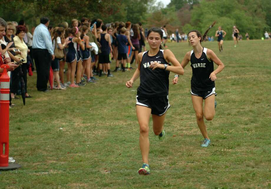 Fairfield Warde's Gabi Galletta and teammate Sarah Radziewicz, in back, approach the finish line during girls cross country action at Wavenly Park in New Canaan, Conn., on Tuesday September 29, 2015. Photo: Christian Abraham / Hearst Connecticut Media / Connecticut Post