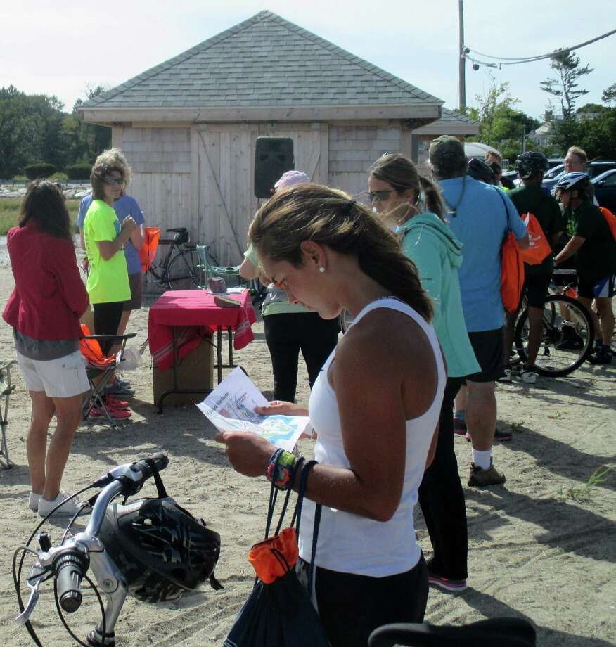 A cyclist checks a map for the new Shoreline Border-to-Border Bike Route on Sunday as the new path was inaugurated by the Fairfield Bicycle and Pedestrian Committee. Photo: Contributed / Contributed Photo / Fairfield Citizen