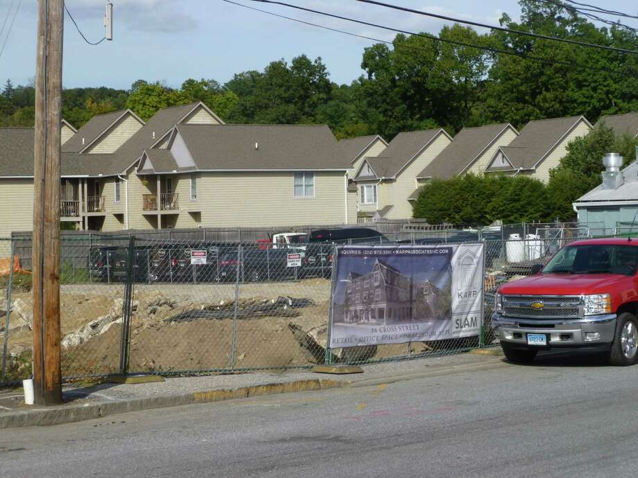 A view of of 16 Cross Street where a developer is building a three story, mixed use building. The area which includes a mixture of service and office uses is included in the draft Cross and Vitti Street Master Plan which includes proposed design guidelines and other  regulations. The document is being reviewed by planning and zoning commissioners this fall. Photo: Martin Cassidy / Hearst Connecticut Media / New Canaan News