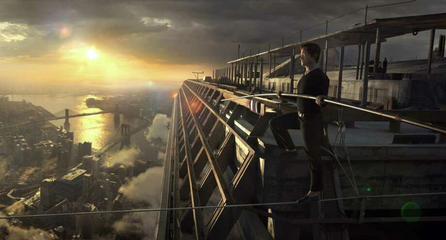 """In this image released by Sony Pictures, Joseph Gordon-Levitt portrays Philippe Petite in a scene from, """"The Walk."""" The film, about high-wire artist Phillippe Petit's cabled walk between the Twin Towers in 1974, opened the 53rd New York Film Festival on Saturday, Sept. 26, 2015.  (Sony Pictures via AP) Photo: Courtesy Of Sony Pictures, HONS / Associated Press / Sony Pictures"""
