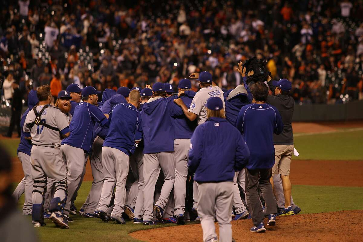 The Los Angeles Dodgers celebrate their 8-0 win over the San Francisco Giants making them the N.L. West Division Champions at AT&T Park September 29, 2015.