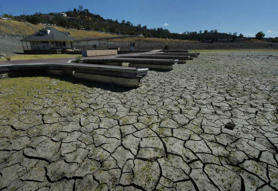 Boat docks sit empty on dry land, as Folsom Lake reservoir near Sacramento stands at only 18 percent capacity, as the severe drought continues in California on September 17, 2015.  California has recently announced sweeping statewide water restrictions for the first time in history in order to combat the region's devastating drought, the worst since records began.  Photo: MARK RALSTON, Mark Ralston/Getty / AFP