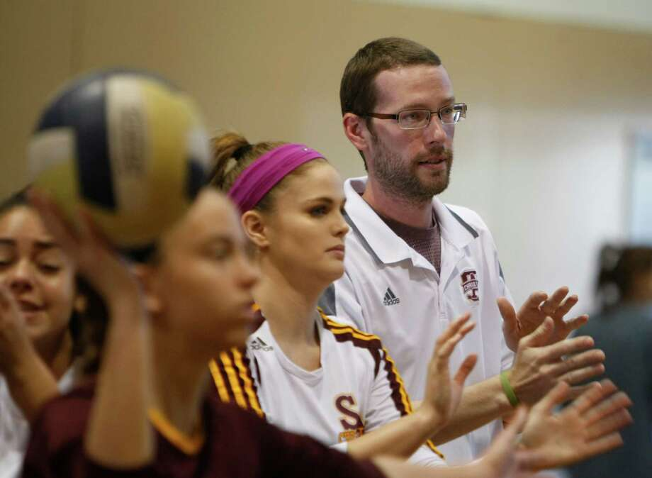 Coach Noah Miller gives instruction before their game against Pleasanton on Sept. 12, 2015. San Antonio Christian's Miller coaching the junior-varsity in a tournament match at Holy Cross. Miller was dealt a death sentence when he was diagnosed with brain cancer in February. Photo: Ron Cortes /For The Express-News