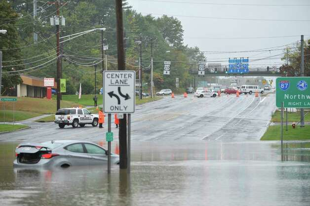 Traffic is blocked from a flooded section of Western Ave. just in front of Stuyvesant Plaza on Wednesday, Sept. 30, 2015, in Albany, N.Y.  (Paul Buckowski / Times Union) Photo: STAFF / 10033561A