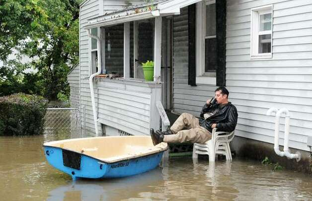 Anthony Catalano sips a coffee as he waits for the call to evacuate his Sumpter Street home Colonie, NY, on Wednesday, Sept. 30, 2015. (John Carl D'Annibale/Times Union)
