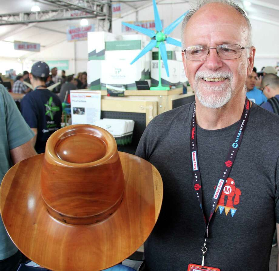 Carl Stoner displays the hat that he fashioned from wood at the World Maker Faire in New York. Photo: Mark Mathias / Mark Mathias / Westport News