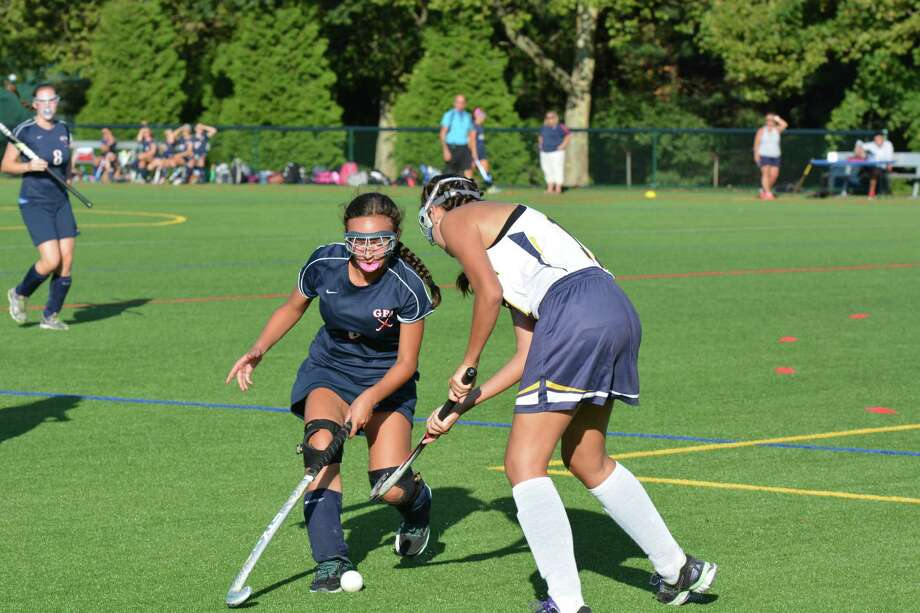 Greens Farms Academy sophomore Devon Wolfe,left, of Darien challenges a Cheshire Academy defender in GFA's 1-0 victory on Sept. 24. Photo: Contributed / Darien News