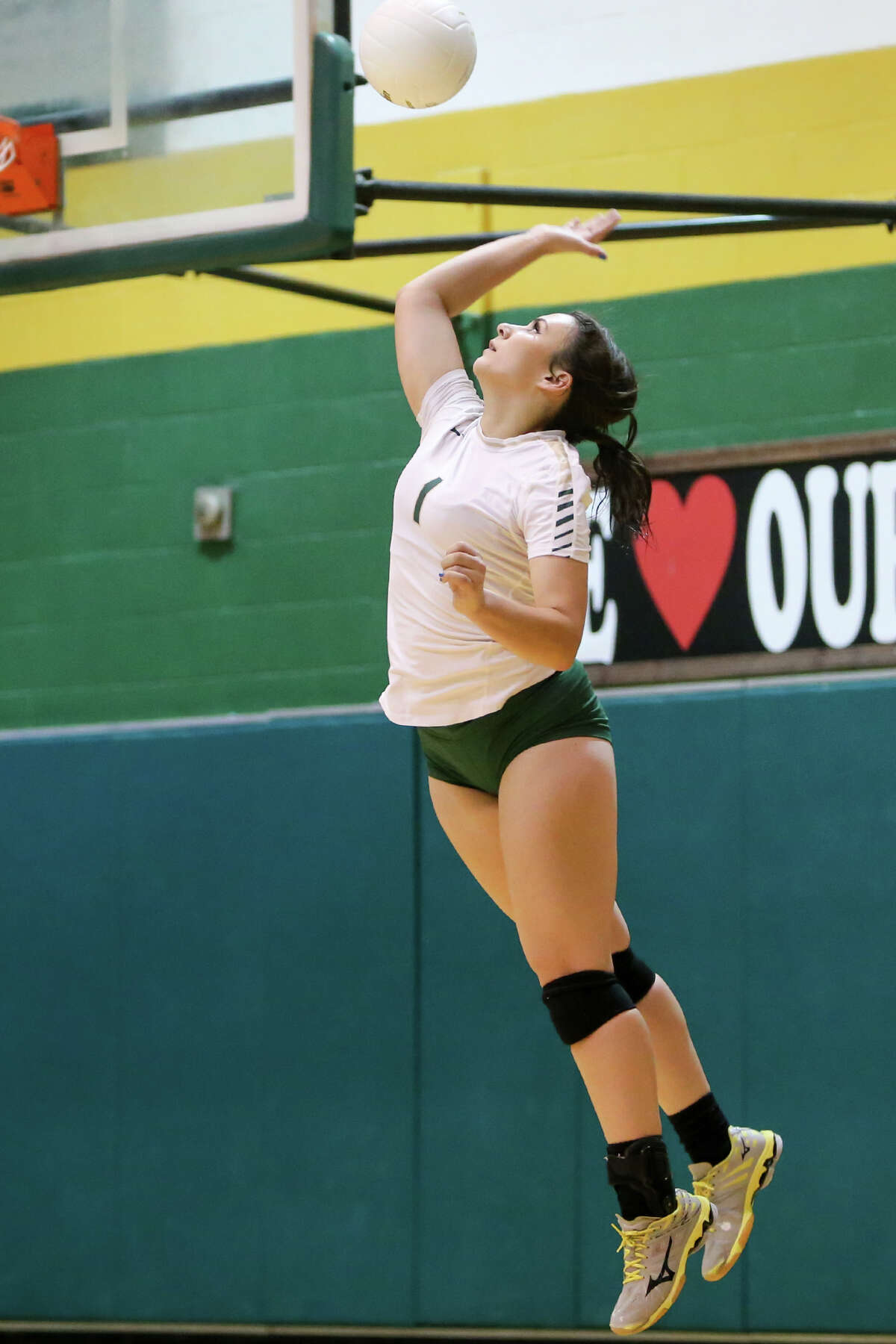 McCollum's Miranda Rich serves the ball during their match with Edison at McCollum on Tuesday, Sept. 22, 2015. McCollum beat the Lady Bears in three straight sets: 25-18, 25-20, 25-21. Both teams were undefeated in District 28-5A play with 6-0 records coming into the match. MARVIN PFEIFFER/ mpfeiffer@express-news.net