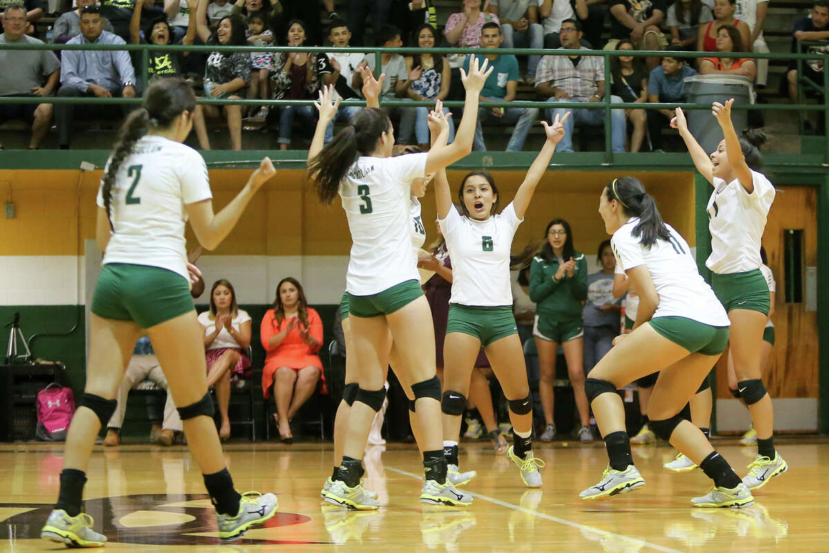 The McCollum Cowgirls celebrate their victory over Edison during their match at McCollum on Tuesday, Sept. 22, 2015. McCollum beat the Lady Bears in three straight sets: 25-18, 25-20, 25-21. Both teams were undefeated in District 28-5A play with 6-0 records coming into the match. MARVIN PFEIFFER/ mpfeiffer@express-news.net