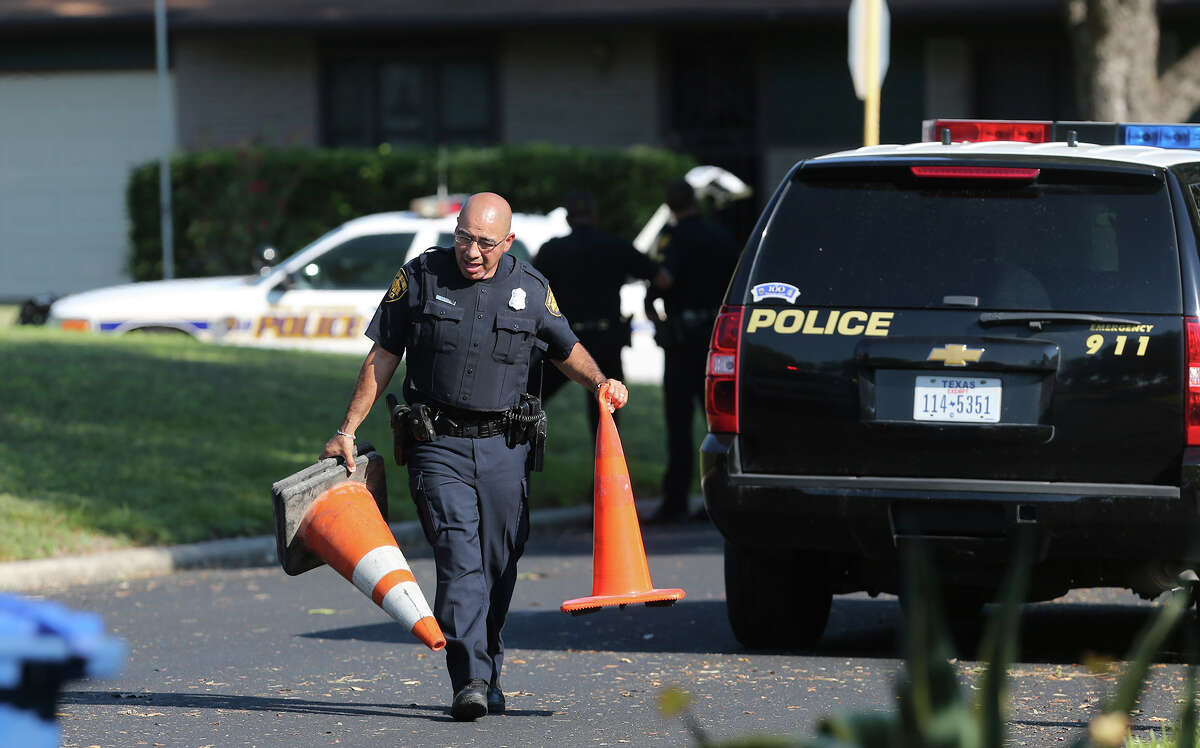 A San Antonio police officer blocks the road Wednesday September 30, 2015 during standoff situation on the 3000 block of Sage Hill. A person at a home in the area has allegedy been firing shots.