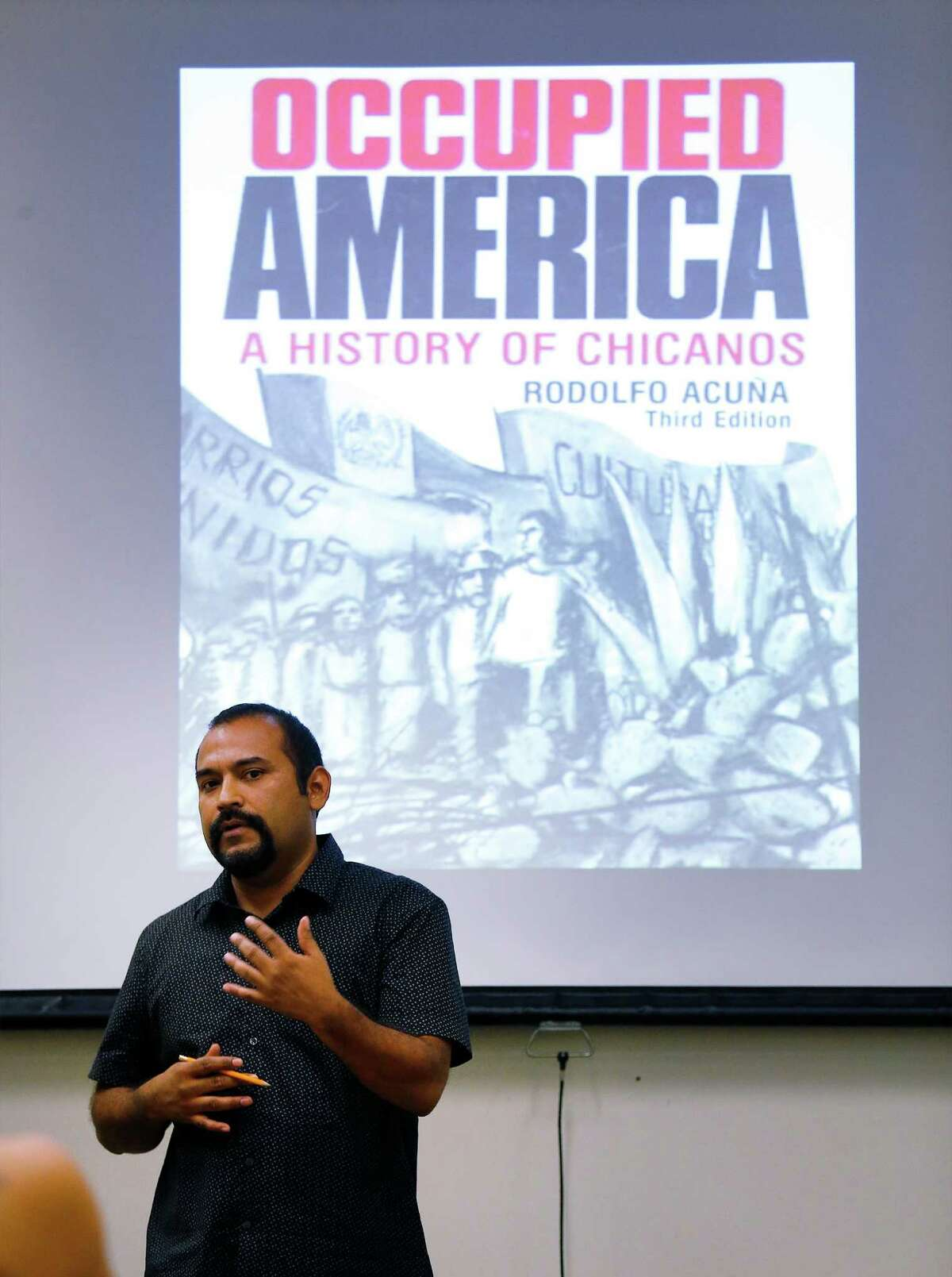 Marco Cervantes teaches a Mexican-Americans in the South- west class at UTSA, where he's worked for 4 ½ years.