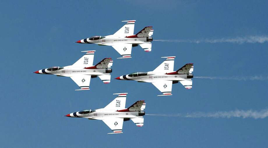 """BARKSDALE AIR FORCE BASE, La. -- The U.S. Air Force Thunderbirds perform at the 2003 """"Defenders of Freedom"""" air show held May 10-11.  (U.S. Air Force photo by Staff Sgt. Denise A. Rayder) Photo: SSgt Denise Rayder, California Capital Airshow. / digital"""