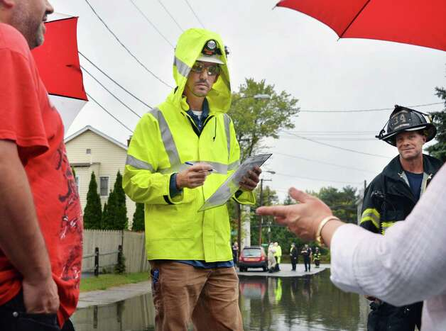 National Grid's Matt Thompson, center, speaks with evacuated home owners on Corning Street  Wednesday Sept. 30, 2015 in Colonie, NY.  (John Carl D'Annibale / Times Union) Photo: John Carl D'Annibale / 10033561A