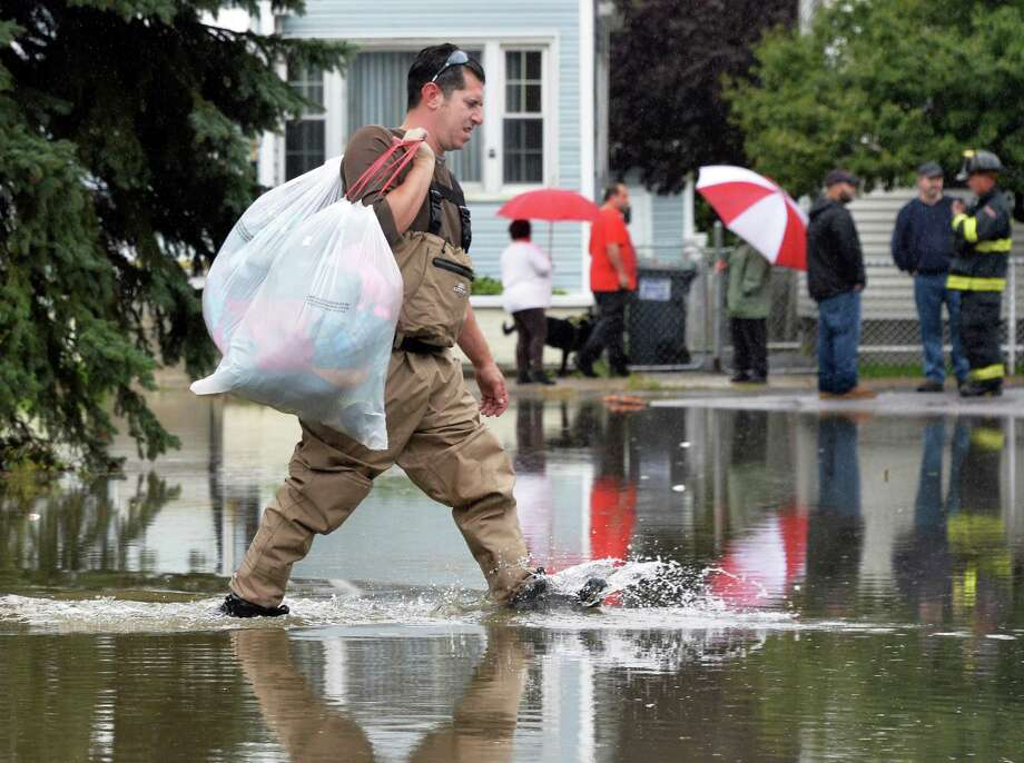 Anthony Catalano carries belongings as he evacuate his Sumpter St. home Wednesday Sept. 30, 2015 in Colonie, NY.  (John Carl D'Annibale / Times Union) Photo: John Carl D'Annibale / 10033561A