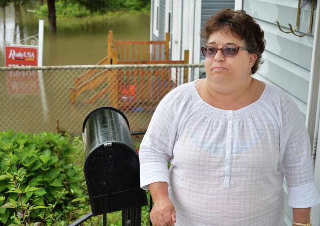 Cindy Hart prepares to evacuate her on Corning Street home Wednesday Sept. 30, 2015 in Colonie, NY.  (John Carl D'Annibale / Times Union) Photo: John Carl D'Annibale / 10033561A