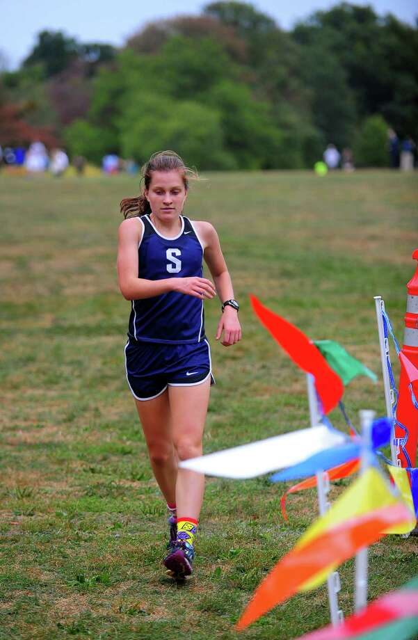 Staples' Hannah DeBalsi finishes first during girls cross country action at Wavenly Park in New Canaan, Conn., on Tuesday September 29, 2015. Photo: Christian Abraham / Hearst Connecticut Media / Connecticut Post