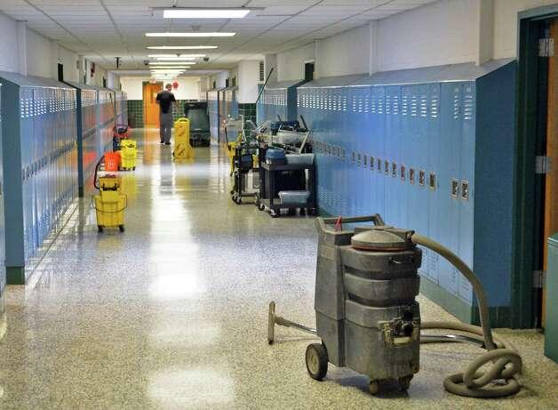 Crews clean up flood damage at Averill Park High School Wednesday, Sept. 30, 2015, in Averill Park, N.Y.  (John Carl D'Annibale / Times Union) Photo: John Carl D'Annibale / 10033561A
