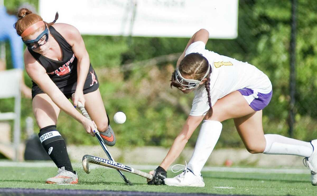 BATTLE FOR THE BALL Stamford High School's Madilyn Caruso, left, and Westhill High School's Paige Sottosanti fight for the ball during a field hockey game played at Westhill.