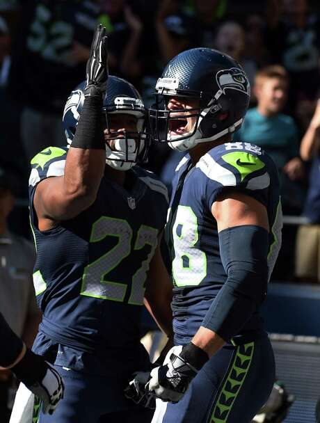 Seahawks TE Jimmy Graham celebrates with running back Fred Jackson after scoring a touchdown in the third quarter of the game against the Chicago Bears at CenturyLink Field on September 27, 2015 in Seattle, Washington. Photo: Steve Dykes, Getty Images / 2015 Getty Images