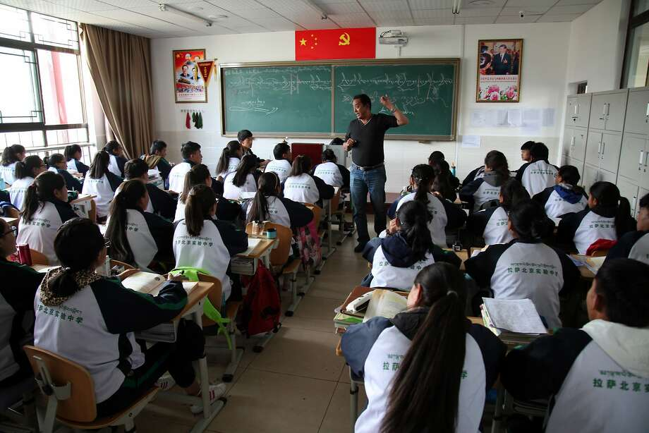 Students listen to a Tibetan-language lesson at the Lhasa-Beijing Experimental Middle School in Lhasa. More than $100 billion dollars in development have poured into the region since 1952. Photo: Aritz Parra, Associated Press