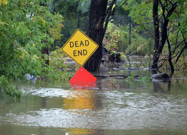 Floodwaters of Patroon and Sand Creeks cover on Corning Street Wednesday Sept. 30, 2015 in Colonie, NY.  (John Carl D'Annibale / Times Union) Photo: John Carl D'Annibale / 10033561A