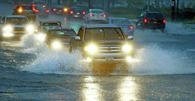 Cars push through high water on Western Avenue near Stuyvesant Plaza early Wednesday morning Sept. 30, 2015 after heavy rainfall in Albany, N.Y.     (Skip Dickstein/Times Union) Photo: SKIP DICKSTEIN