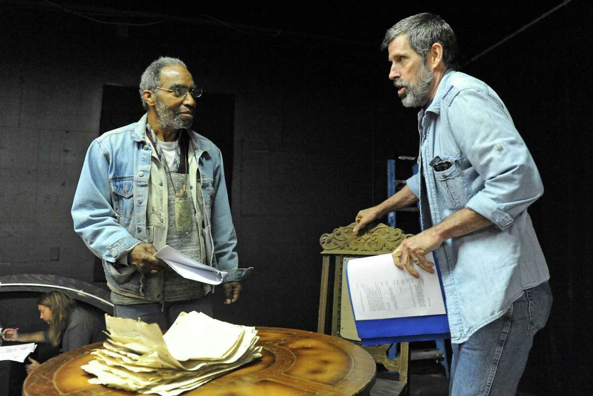 Actors Stephen Jones, left, and Steven Patterson, right, rehearse for the play