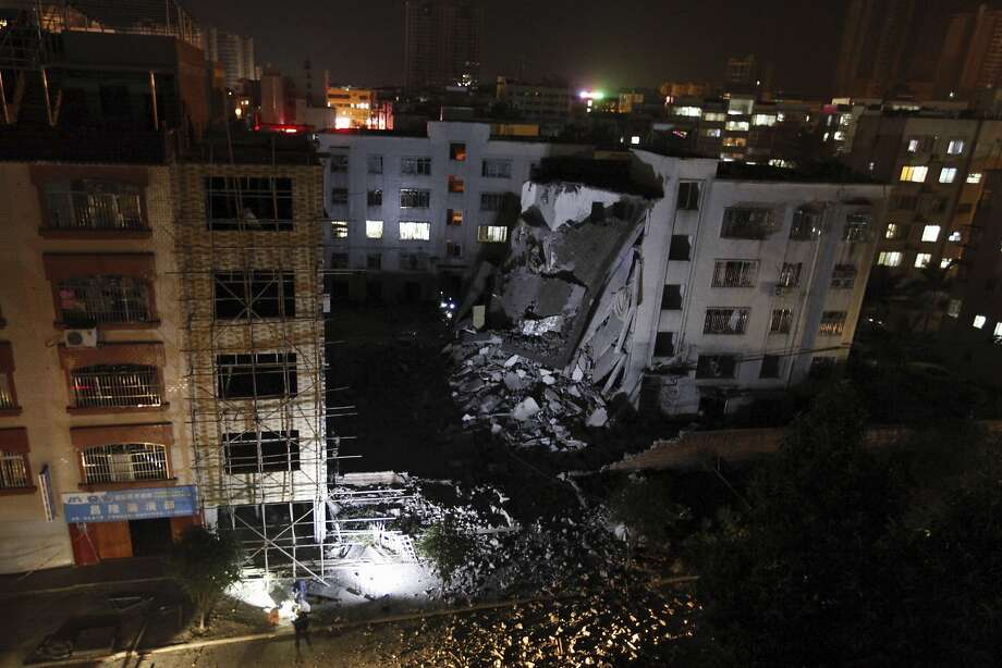 A building was partially collapsed by the force of one of the blasts in Dapu Township, China. Photo: Associated Press