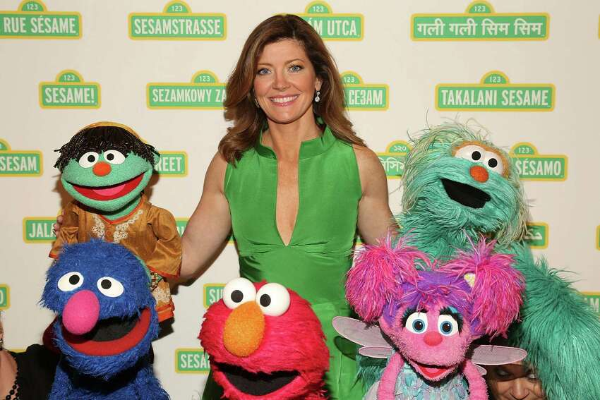 It's Norah O'Donnell, who is seen here posing with Sesame Street Muppets.