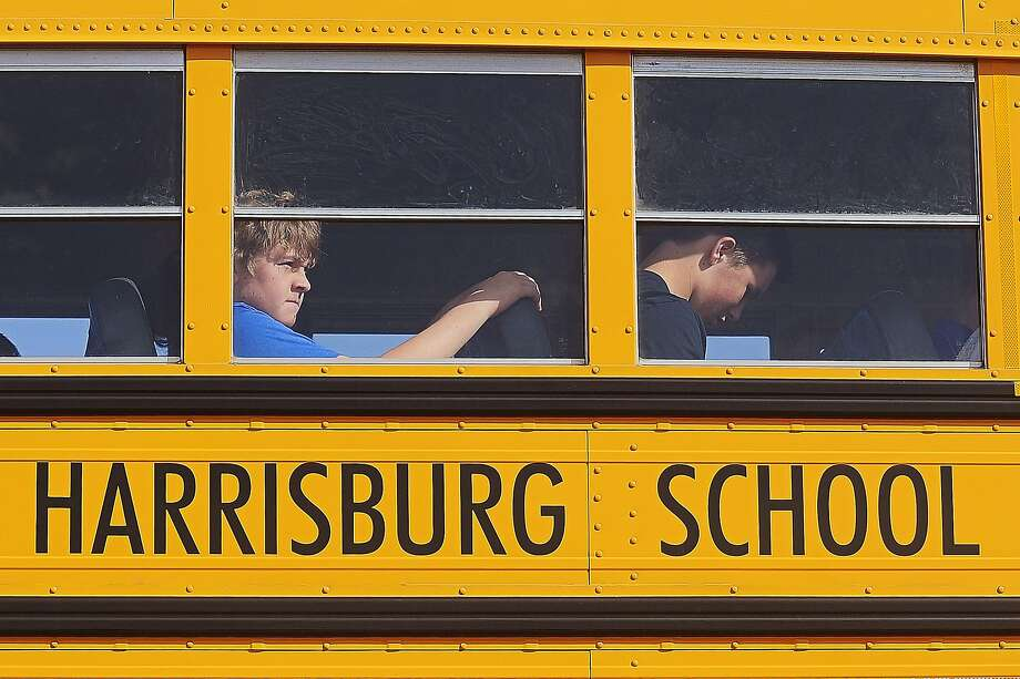 Students are bussed from Harrisburg High School after a shooting at the school in Harrisburg, S.D. Photo: Joe Ahlquist, Associated Press