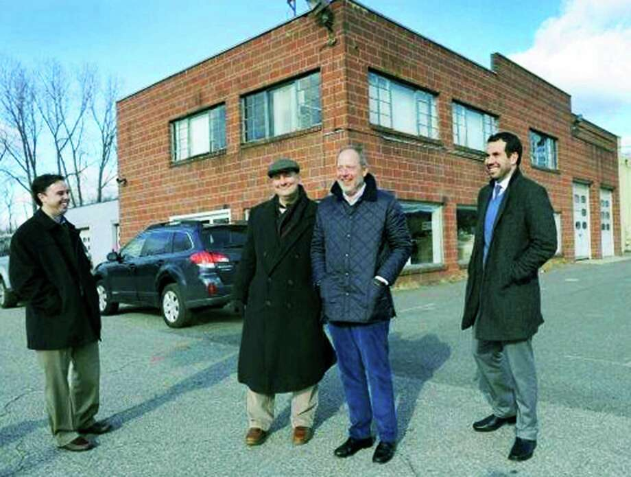 John Lee's property at 91 Park Lane Road would qualify as a brownsfield for a tax deferral under New Milford's revised ordinance. From left, Garett Palmer, of Goodfellow Real Estate, Lee, Goodfelllow President Todd Payne and Luigi Fulinello, New Milford's economic development director, at the old Valley Dodge site. Photo: Carol Kaliff / Hearst Connecticut Media / The News-Times