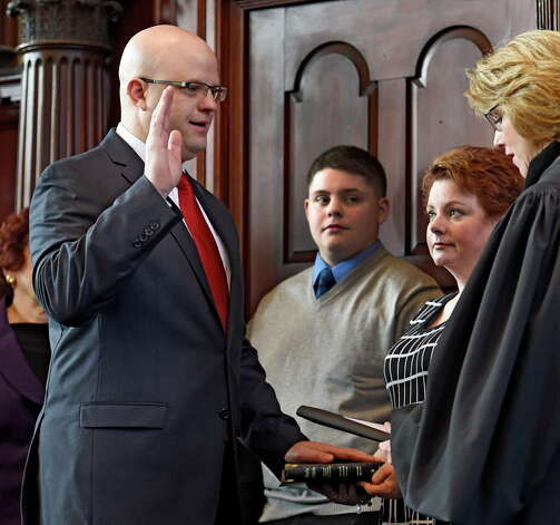 Rensselaer County District Attorney Joel Abelove, left was sworn in  Jan. 1, 2015 by County Judge Debra Young as family members watched at the Rensselaer County Courthouse in Troy, N.Y.   (Skip Dickstein/Times Union) Photo: SKIP DICKSTEIN / 00030034A
