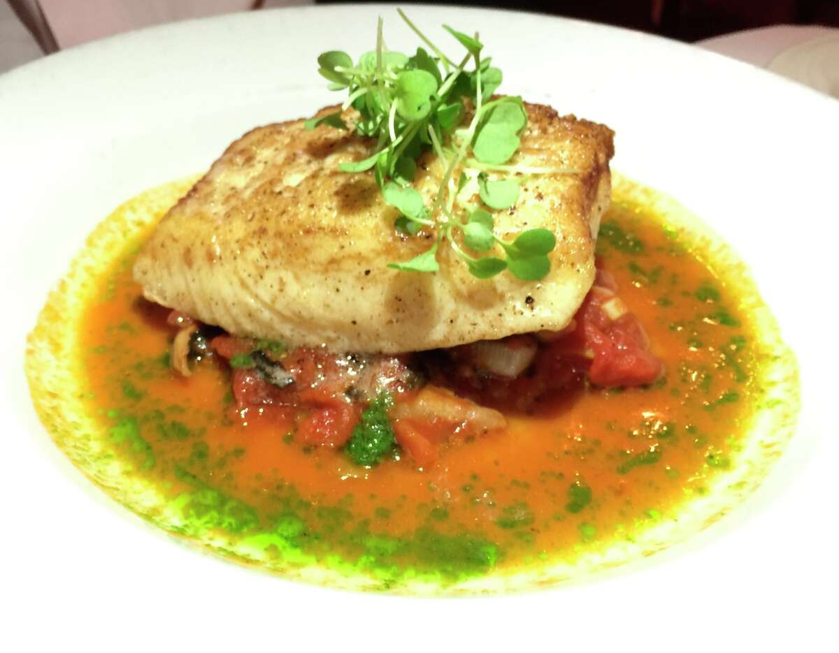Alaskan halibut Livornese ($32) at Frascati, served in a rustic sauce with roasted tomatoes, leeks, charred mushrooms, white wine and salsa verde.