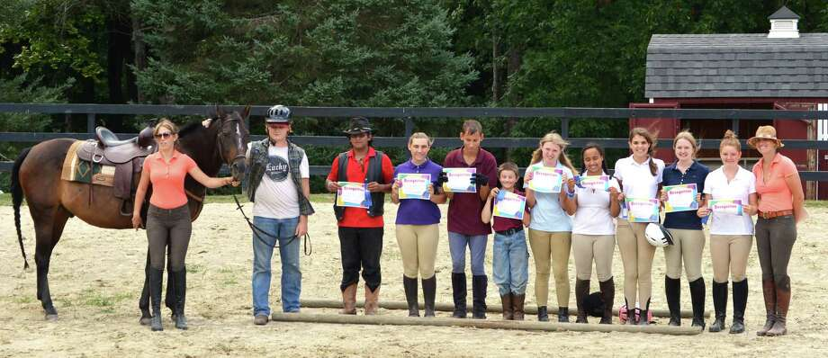 Students of The Glenholme School in Washington recently showcased their riding skills and knowledge in an equestrian demonstration for a large group of family, friends and staff. Pictured, from left to right are Jennifer Vaughn, special education teacher, holding Junior, Kyle Hoover, Ditoyyo Billie, Jiliann Miller, Andrew Diamond, Hunter Whitford, Chloe Cadwell, Lia Osterman, Grace Rocco, Courtney Hynes, Kelly Mazzo and Sarah Soto, Glenholme equestrian program coordinator. Photo: Courtesy Of Glenholme School
